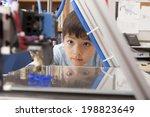 boy watches machine intently. | Shutterstock . vector #198823649