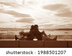 Sepia Image Of Couple Relaxing...