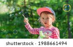 little girl playing with soap...   Shutterstock . vector #1988661494