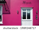 magenta coloured old house.... | Shutterstock . vector #1989248717