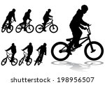 a boy rides a bicycle on a walk.... | Shutterstock . vector #198956507