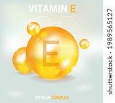 vitamin e in 3d style on gold... | Shutterstock .eps vector #1989565127