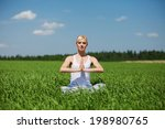 young woman doing yoga exercise ...   Shutterstock . vector #198980765