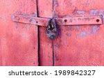 Old Rusty Padlock On A Metal...