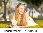 happy young girl with a rose... | Shutterstock . vector #198986231