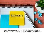Small photo of REWRITE - Word on a note sheet with a cactus in the background. Info concept