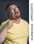 portrait of an emotional man... | Shutterstock . vector #1990152974