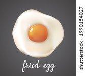 fried egg on dark background....   Shutterstock .eps vector #1990154027