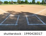 A Baseball Field With A Raised...