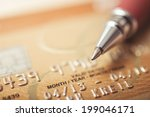 credit card and pen up close | Shutterstock . vector #199046171
