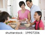 family in the kitchen eating... | Shutterstock . vector #19907206