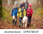 family walking dog through... | Shutterstock . vector #199078019