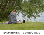 Young Woman Sitting On The Bank ...