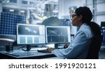 Small photo of Female Engineer uses Computer to Analyse Satellite, Calculate Orbital Trajectory Tracking. Aerospace Agency International Space Mission: Scientists Working on Spacecraft Construction. Over Shoulder