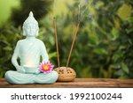 Buddha Statue With Burning...