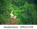 Woman Meditating In Lotus...