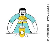 hungry man eating burger and... | Shutterstock .eps vector #1992326657