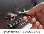Woman plug an hdmi cable into a ...