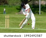 Small photo of ELGIN, MORAY, SCOTLAND - 5 JUNE 2021. This is a Cricket match being played in Cooper Park of Elgin, Moray, Scotland on 5 June 2021.