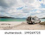 camper van parked on a beach in ...