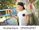 Cute Toddler Boy In Street...
