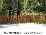 Wooden Picket Fence In A Green...