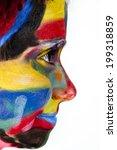 portrait of young girl in paints | Shutterstock . vector #199318859