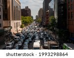 Small photo of New York NY USA-June 18, 2021 Vehicles clog Tenth Avenue in New York, approaching the Lincoln Tunnel