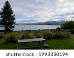 Bench And Lake Tekapo In New...