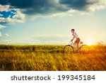 happy young woman riding...   Shutterstock . vector #199345184