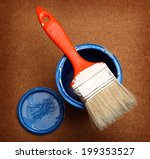 brush painting on tin can of...