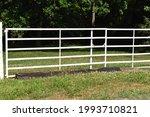 White Gate In A Farm Field