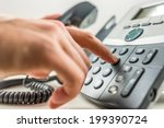 closeup of male hand dialing a... | Shutterstock . vector #199390724