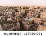 Small photo of A unfavorable neighborhood for the poor population of the old town. Sheds on the roofs of houses.