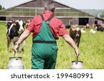 Farmer With Milk Churns At His...