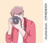 photographer man cartoon... | Shutterstock .eps vector #1994838404