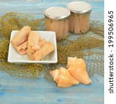 Small photo of Albacore tuna in olive oil canned glass on wooden table