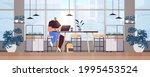 businessman sitting at... | Shutterstock .eps vector #1995453524