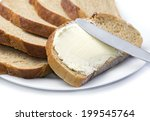a knife spreading butter on... | Shutterstock . vector #199545764