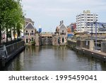 Small photo of Zaandam, The Netherlands - June 10, 2019; View of the lock master's house and the excise house of the Hondsbossche Sluis from the side of the Voorzaan.