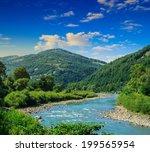 wild river flowing between...