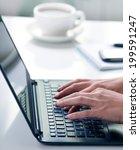 woman hands typing on laptop | Shutterstock . vector #199591247