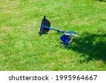 A Fallen Scooter On The Grass...