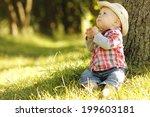 a little boy playing cowboy in... | Shutterstock . vector #199603181