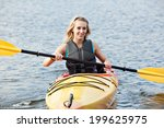 Young Woman Sea Kayaking
