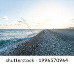 Fishers With Fish Rods On Sea...