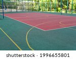Small photo of A multipurpose playground with rubber coating and markings for tennis, basketball and volleyball.