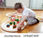 little boy playing with wooden... | Shutterstock . vector #199687409