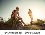 two hikers with backpacks... | Shutterstock . vector #199692305