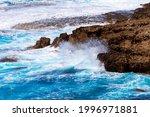 Ocean Waves Splash Against...